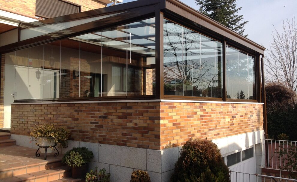 Cortina de cristal y techo corredizo